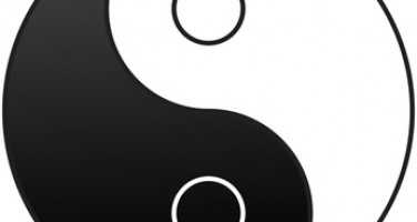 Gender symbols embedded on the Yin and Yang symbol used to demonstrate the opposite qualities of men and women