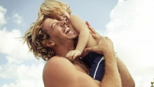 Father hugging son and laughing