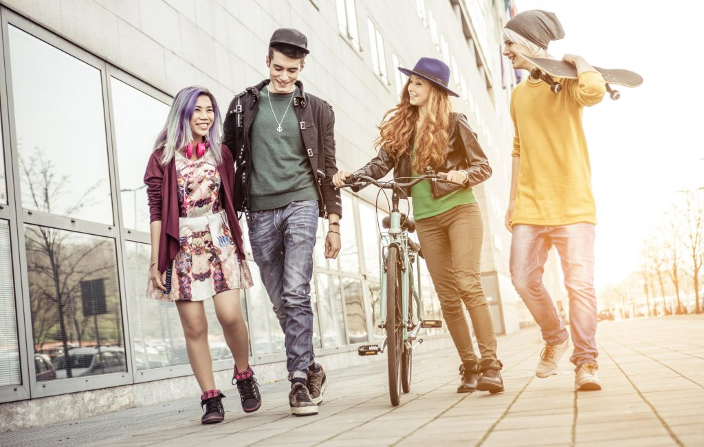Group of teens walking in an urban area. Concept about friendship and youth