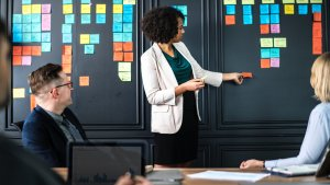 Woman in meeting with post-it notes